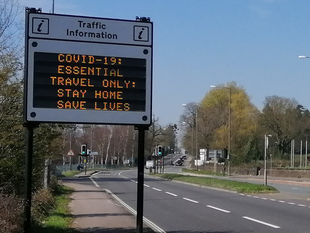 Adaptive road sign: Coronavirus - Essential travel only - Stay home - Save lives